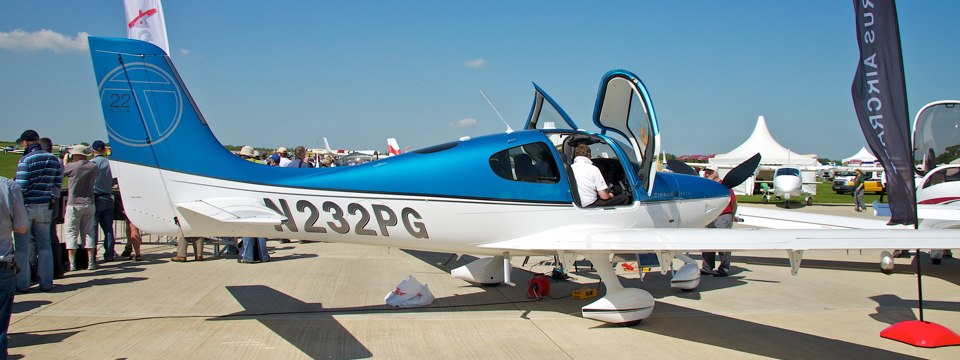 A blue and white Cirrus SR22 on static display