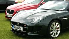 Two luxury cars at AeroExpo UK