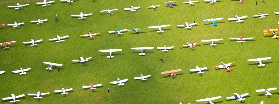 Visiting aircraft parked on the grass at AeroExpo UK