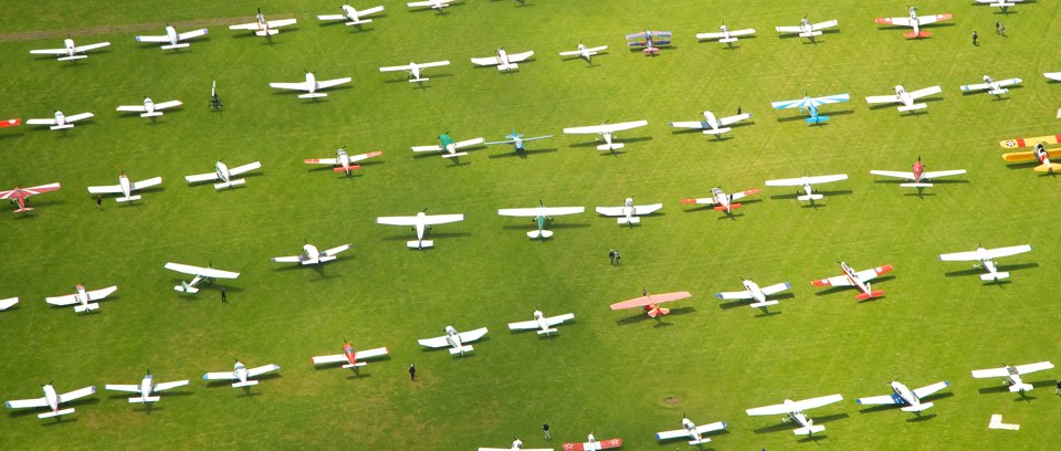 Visiting aircraft parked on the grass at AeroExpo UK